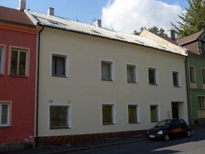 Dům snebytovými prostory a byty